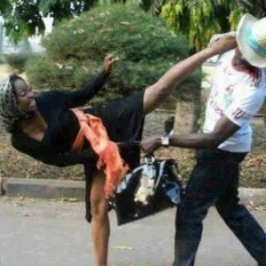 woman beating man KU