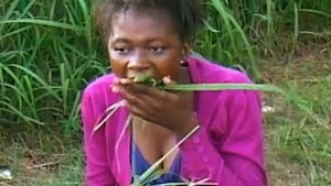 woman eating grass in machakos