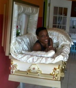 lady posing in coffin for picture