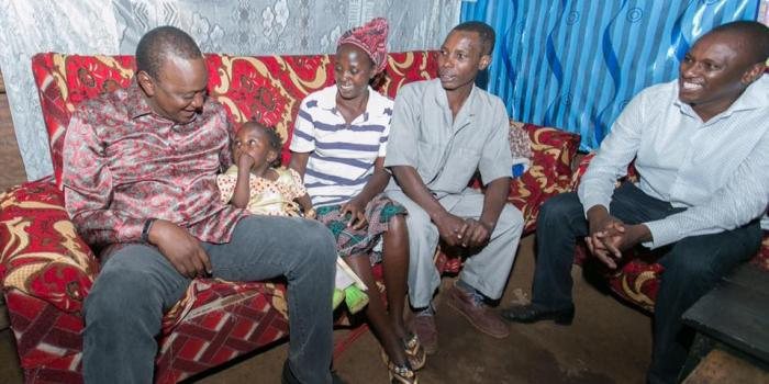 UHURU VISITS POOR VILLAGERS IN THEIR MUD HOUSES