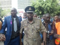 POLICE SPOKESMAN FORCED TO CARRY COFFIN